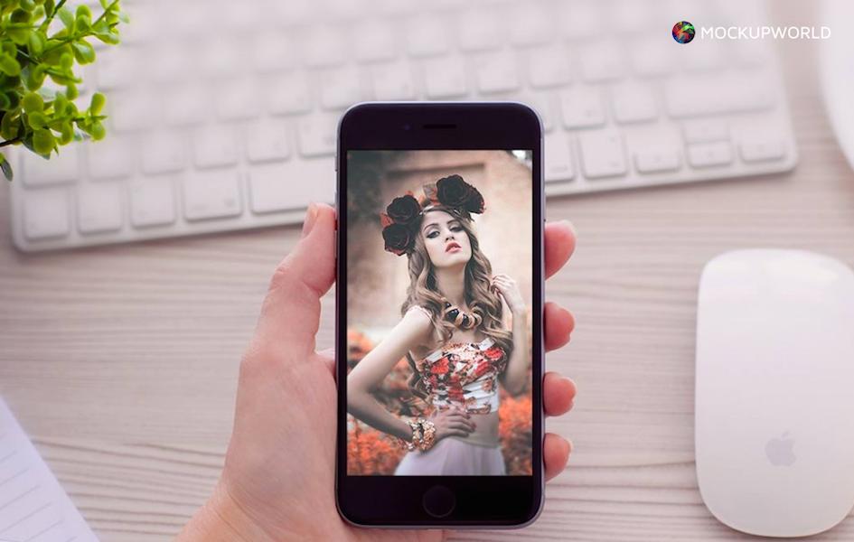 Hand Holding a Vertical iPhone Mockup, free design mockups